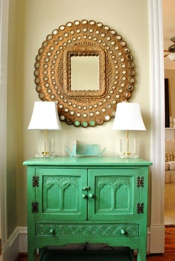 as a bold statement piece- focusing more on the furniture aspect of the mirror than reflective qualities