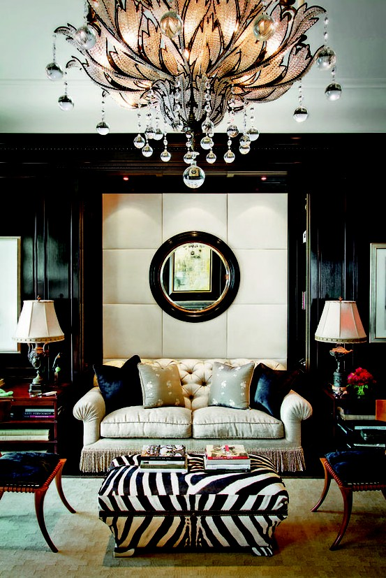 using a mirror as an anchor- creating symmetry (or even faux symmetry) in a space helps enhance decor