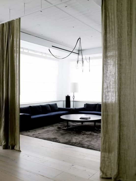 These curtains add a bit more privacy to an open space. Curtains as partitions or room dividers would be great in a studio or loft apartment.