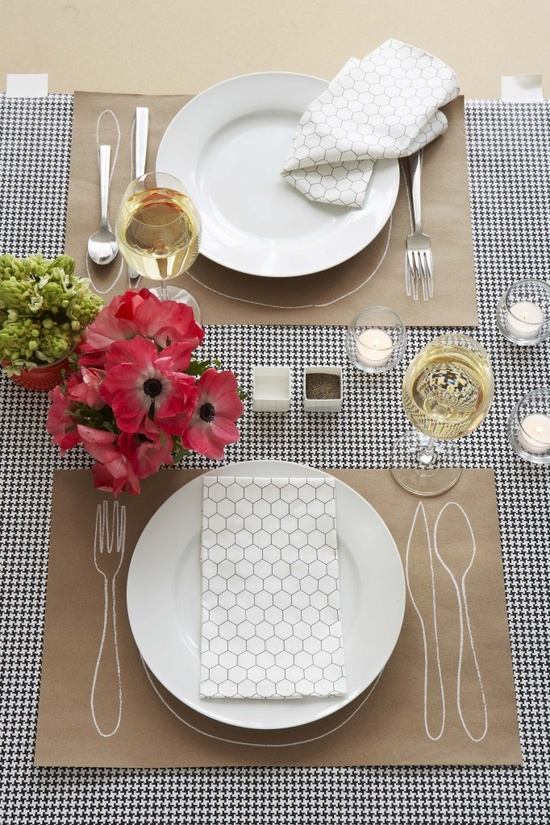brilliant idea! these are paper placemats... you can make your own or buy pads of them! easy to clean up and not expensive at all!