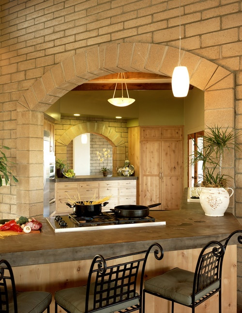 CONCRETE. I love the idea of concrete countertops for an outdoor bar and patio. Or even a tuscan style home decor.