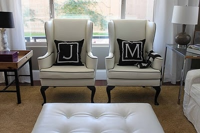 a simple and understated look for a pair of his and her chairs