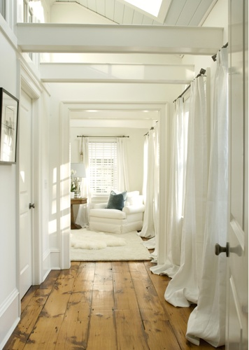Love this idea of putting long flowing curtains in a hallway. These curtains are the same color as the walls so it doesn't make the hallway seem narrower, just more dimensional. Love.