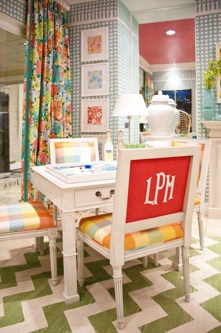 now this would cost a pretty penny or would take a lot of upholstery planning... but I love the idea! Even for your dining room chairs too!