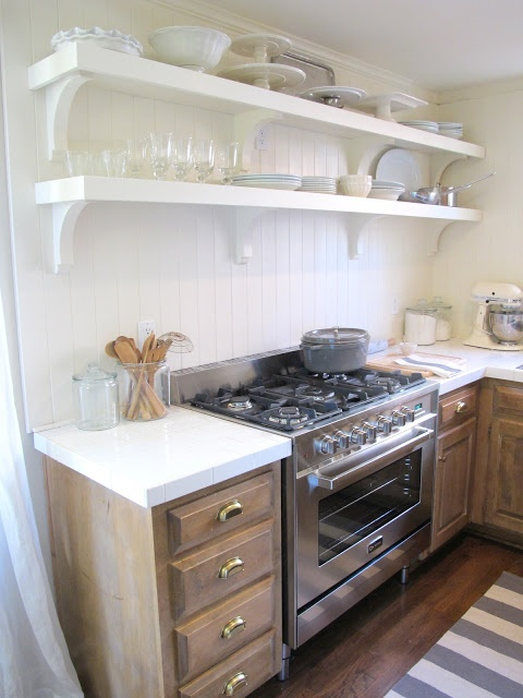 SUBWAY TILE WHITE. well besides my obsession with subway tile in general... these give a fresh look to this small kitchen.