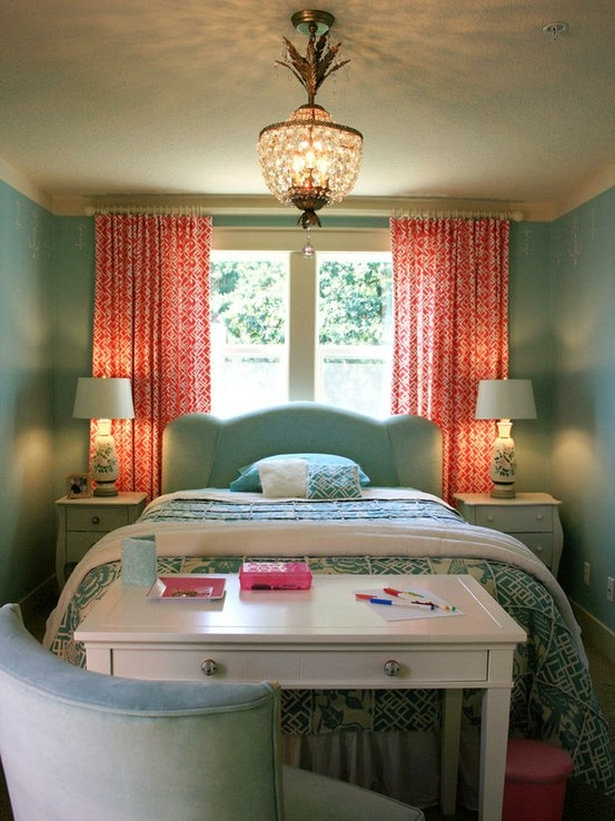 Love this idea for a smaller bedroom with great windows. What a unique way to position the bed and use the curtains as a headboard like piece. Love. And I LOVE the color combinations here.