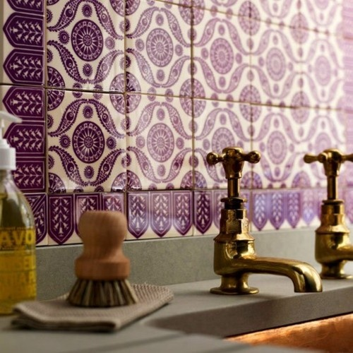 I love the idea of this ornate tile. Using the tile and backsplash as the color in the room instead of wall paint. Love.