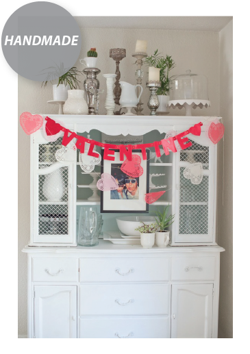 When in doubt, hand make a few decorations to spice up your space. Create garland of paper hearts or even Valentine's Day cards you have received in the past. Simple and very cost effective.