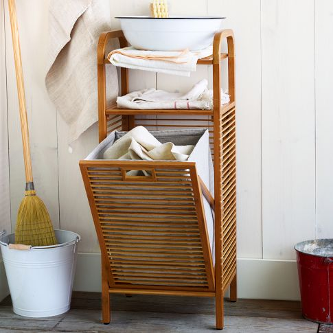 For small spaces like the bathroom you want furniture to have dual functions! This is the Bamboo Laundry Hamper Ritz that has a hamper beneath and storage up top. This is on sale at West Elm for $119 (originally $149)