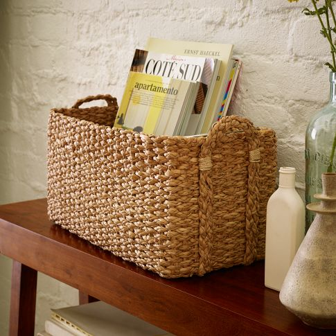 For even more organization throw a few woven baskets under the bench to hold towels. These are the Braided Console Basket from West Elm for only $24.