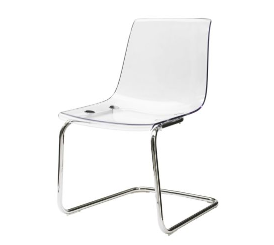 This is the TOBIAS chair from Ikea for $79.99. Also available in a translucent grey color as well!