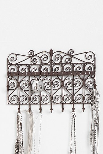This is the Scrollwork Gate Jewelry Stand at Urban Outfitters for $29. Great for necklace lovers of all kind! Also great for someone with not a lot of countertop space!