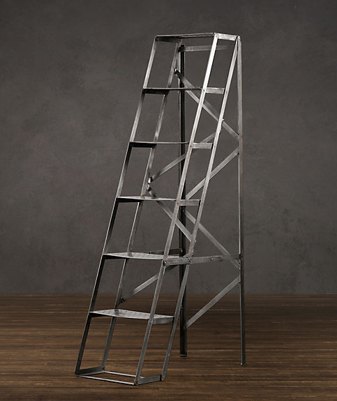On bit of a splurge, this is the Mid Century Shop Ladder Shelving from Restoration Hardware for $499. Would be a beautiful piece for any large living space!