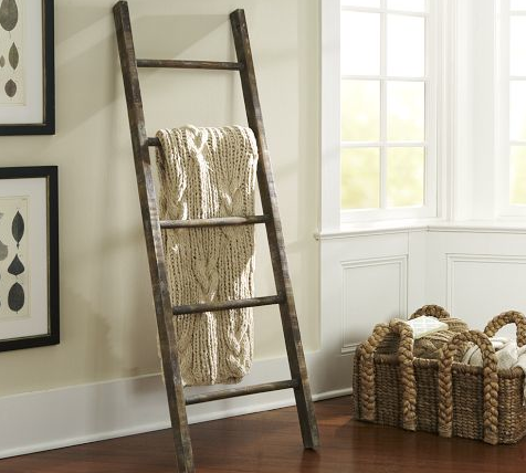 A perfect blanket organizer or ever towel rack for a rustic bathroom. This is the Pottery  Barn Prop Collection 5' Rustic Ladder for $179
