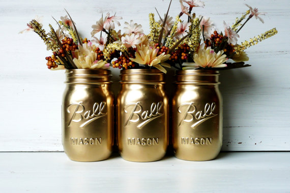 Perfect for a kitchen window... this set of three gold painted mason jars is only  $18 from Beach Blue's Etsy shop