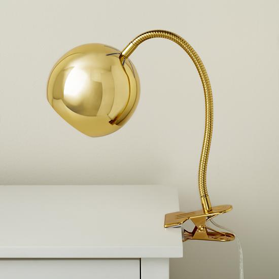 How cute for a bedside! This is the Gold Modern Light Clip from Land of The Nod for $59