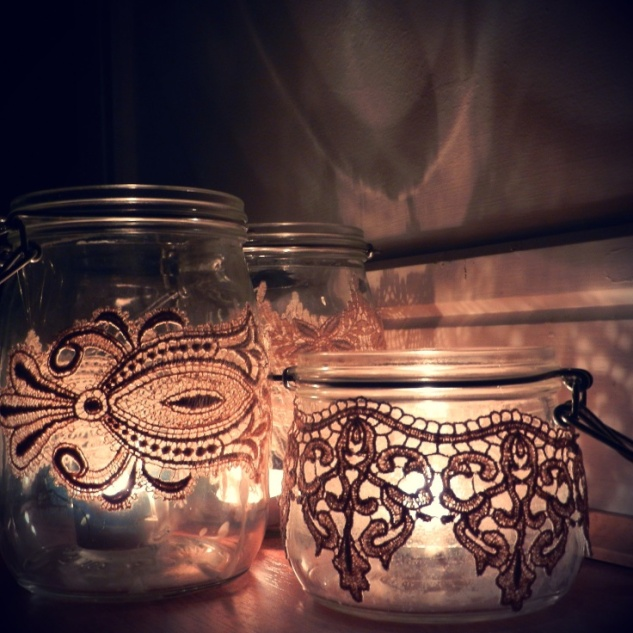 Vintage lace wrapped around tea light candle holders... how beautiful when they are all lit up!