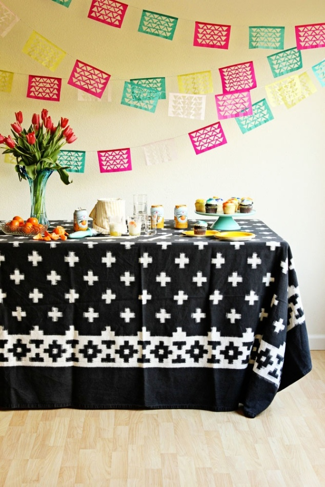 Make a very EASY tablescape for appetizers and drinks with a festive and wild patterned table cloth and a few colorful dishes!