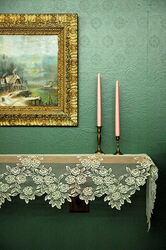 Adding a vintage lace table cloth next to a brightly colored wall. love love love.