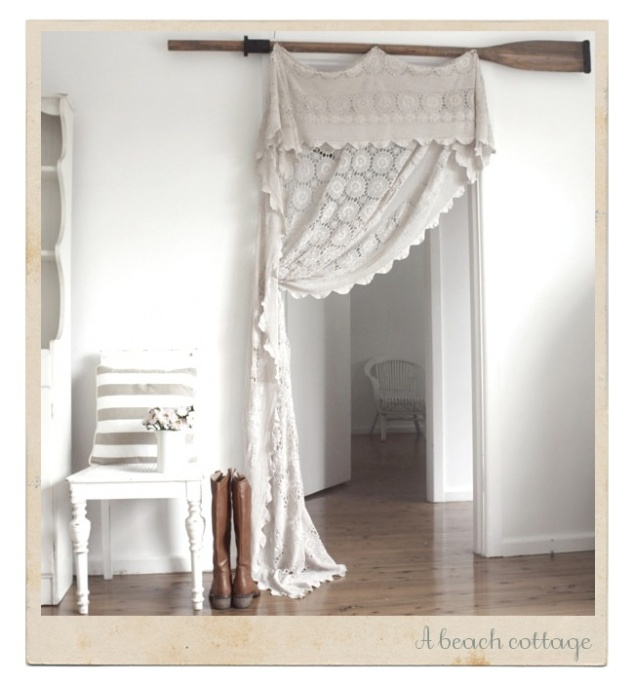 LOVE THIS! Hanging an old lace tablecloth! Gorgeous.