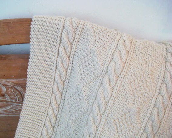 This is a great hand knitted throw from Jackubina's Etsy Shop. This throw is 33 x 46 and goes for only $110