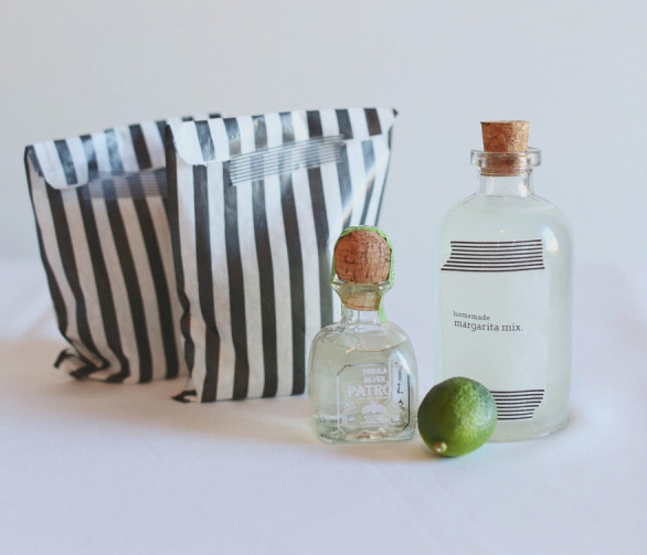 Ending the evening with simple and easy party favors! Find adorable bags and place individual tequila bottles, lime, and homemade margarita mix for a fun take home for your guests!