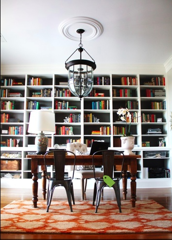 I love the idea of floor to ceiling book shelves in an office!