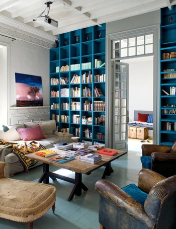Floor to ceiling book shelves as a way to color a room! LOVE.