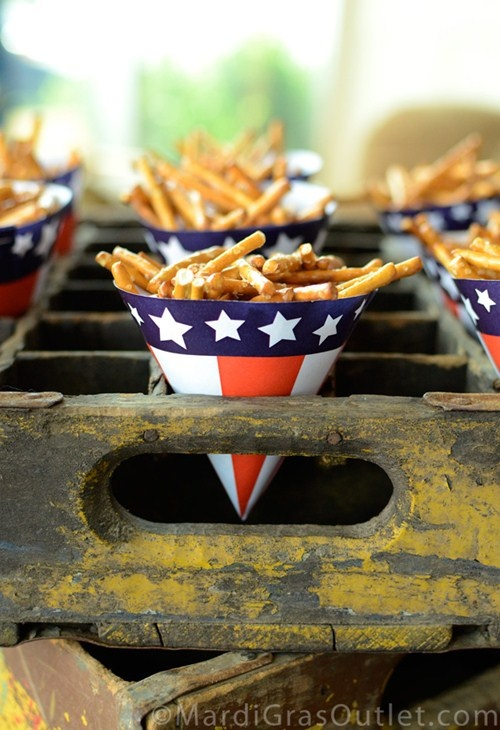 Love this idea! How simple... just get America themed party hats, turn them upside down for great party snack holders!