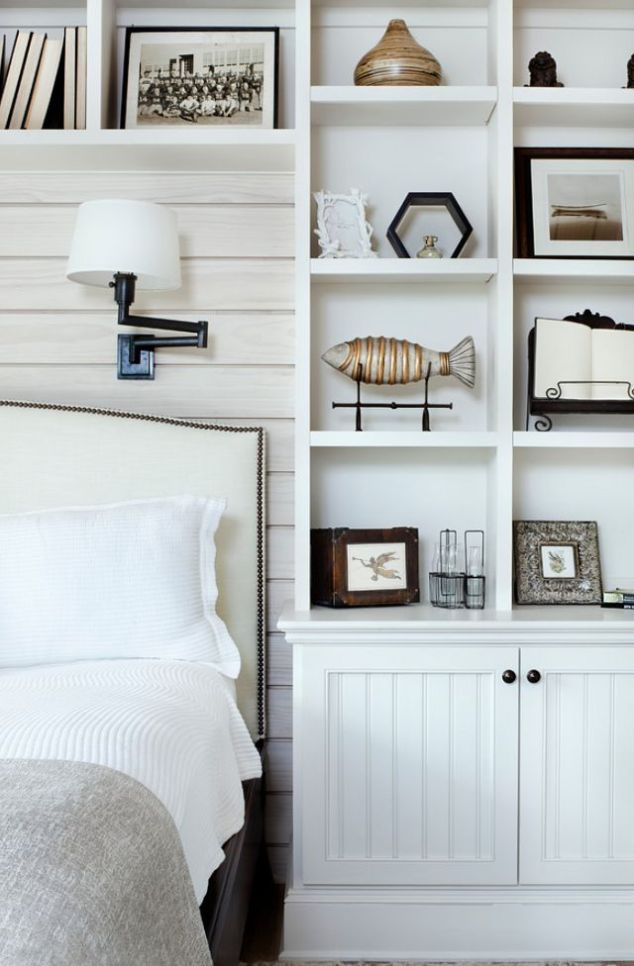 Totally unique idea of having built-ins around your bed, acting as a headboard and bedside table!