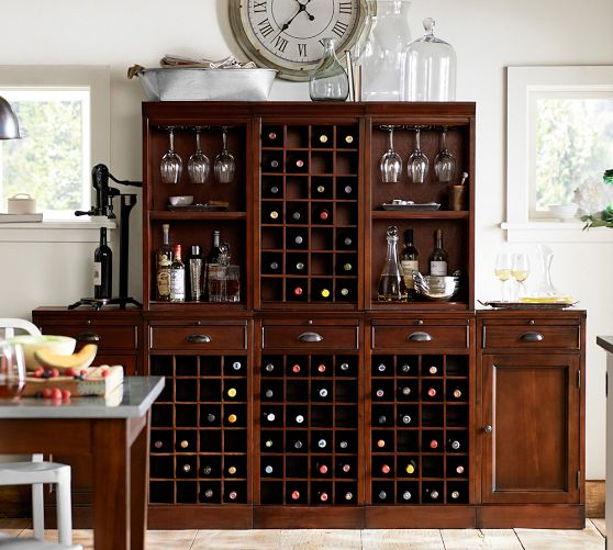 If you are wine obsessed like we are here is the Modular Bar Cabinet with 1 Wine Hutch and 2 Open Hutch from Pottery  Barn for only $2169