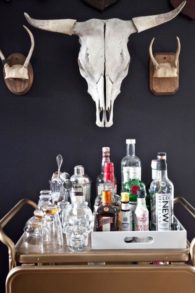 a longhorn skull is definitely a must somewhere in this living room. I am thinking coffee table piece though. But I love this dark wall contrast.