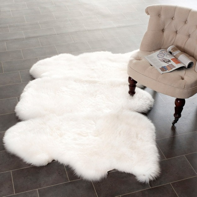 A little bit larger, this is the Prairie Sheepskin Wool White Shag Rug from Overstock.com on sale right now for only $171.69