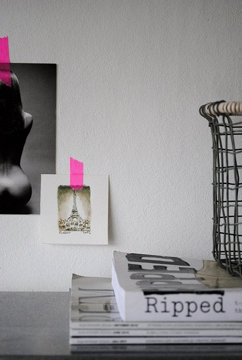 I love these black and white photos with brightly colored tape! Perfect for a space where you might not be able to hang photos or make permanent marks!