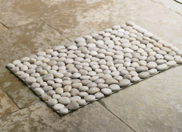 A gorgeous stone welcome mat is as easy a new sheet of tile!