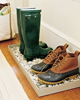 This is my favorite! Its not really a welcome mat but with all of our rainy and snowy shoes here I think this is a brilliant and stylish idea.