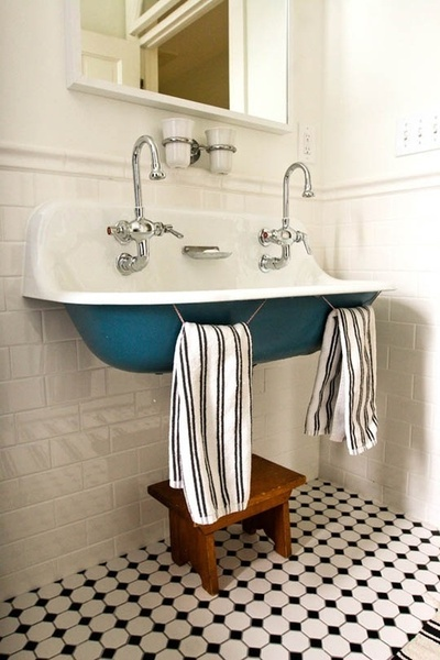 Okay this might not give you a lot of storage in your bathroom but it is just downright adorable!