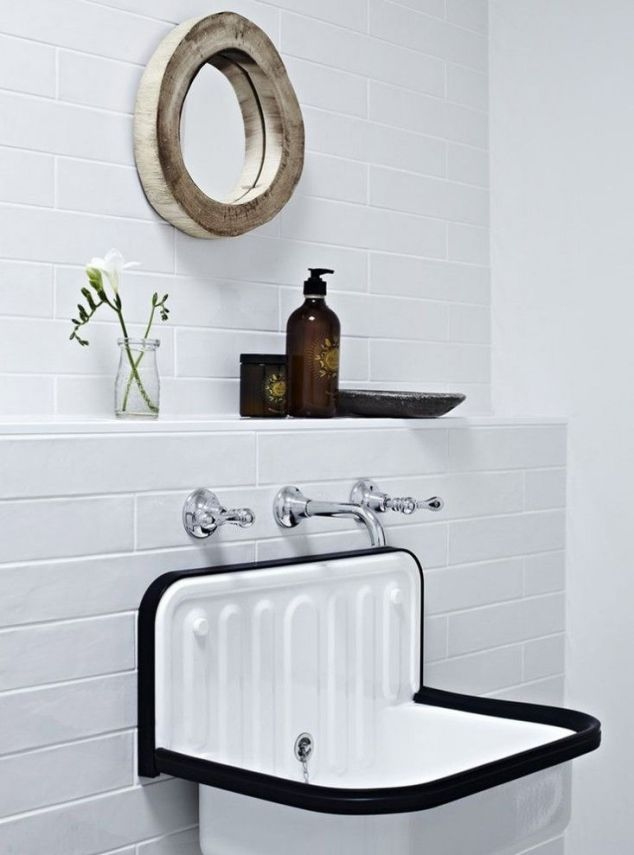 Simple. Love that is updated with a wall mount faucet!