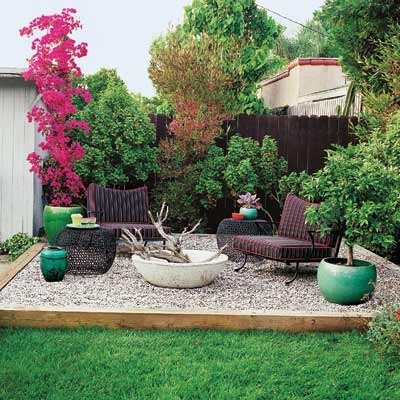 I love this gravel patio surrounded by gorgeous old wood and fresh green grass!