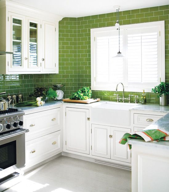 Green subway tiles! What a fresh green and white kitchen and a new spin on the tile that has made a huge comeback in recent years.