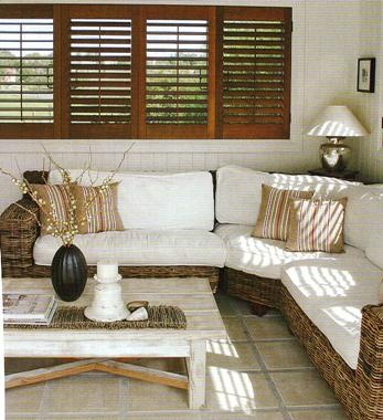 I love the contrasting wood shutters with white walls!