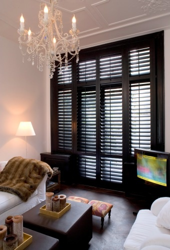 I love that these shutters are a bold statement in this room!