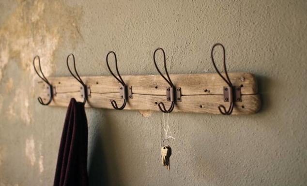This Recycled Wood Coat Rack with Vintage Wire Hangers for only $32.95! This would be perfect in our front entry way! Or your kitchen to hang up aprons!