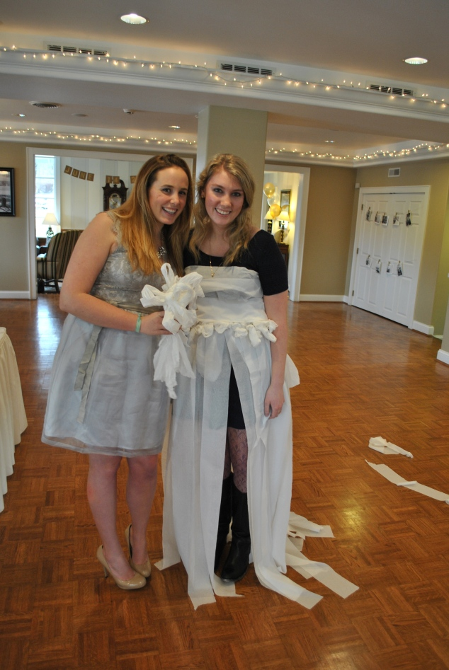 The bridal shower favorite of the Rumpke family, the toilet paper wedding dress! Each table makes their own toilet paper wedding dress and the bride judges which dress is her favorite!