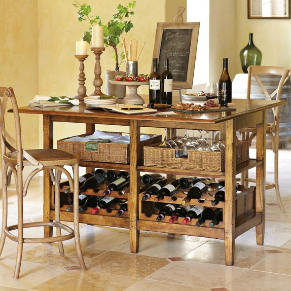 I LOVE THIS! This is the La Bergerie Wine Tasting Table in Oak from William Sonoma for $1,950. Combining things we love with things we need!