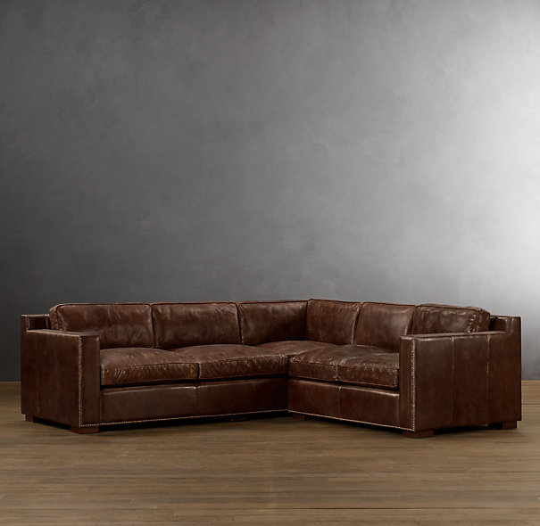 Now we're thinking a leather sectional, because I know I won't be able to get David to give his leather couch up without replacing it with another leather couch. I of course am obsessed with this one from Restoration Hardware. (The Collins Sectional)