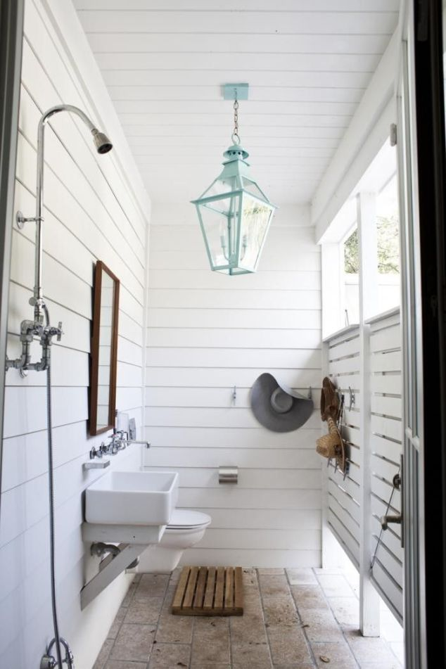 The perfect accessory to a backyard pool is an outdoor bathroom. LOVE!