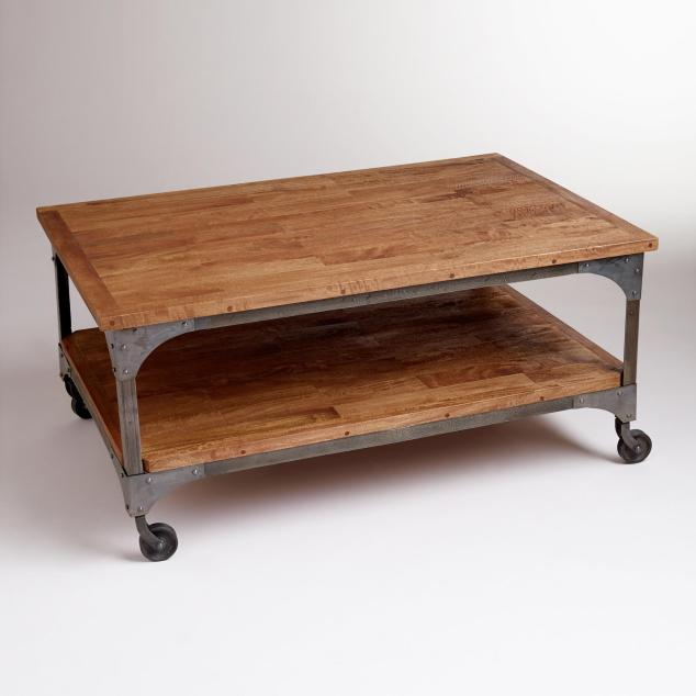 This is the perfect rustic coffee table from World Market. The AIDEN COFFEE TABLE on sale right now for $289.99