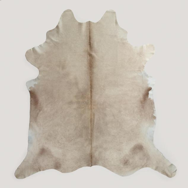 This is the perfect neutral cowhide rug. The LIGHT NATURAL COWHIDE RUG from World Market on sale for $314.99