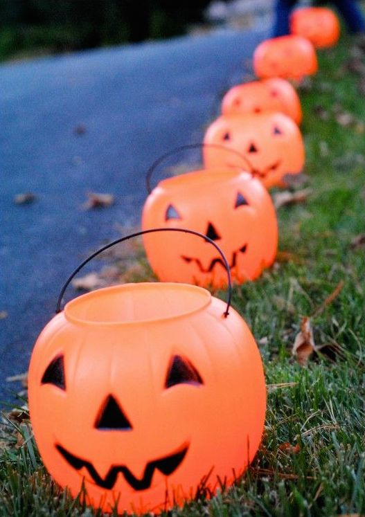 These are always available at the dollar section in Target. Line the driveway and put a tea light in them to light the path for trick or treaters.